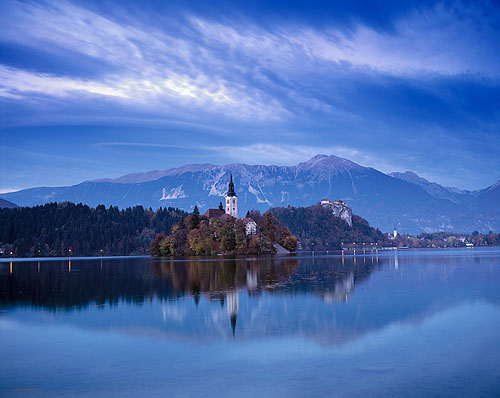 Lake Bled and Blejski Otok with Bled Castle behind, Slovenia.