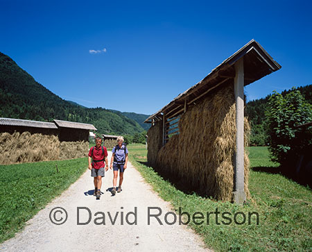 Walking by hayracks in Zgornja Dolina, Bohinj